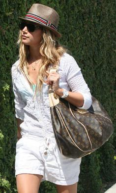 Ashley Tisdale wearing a straw fedora
