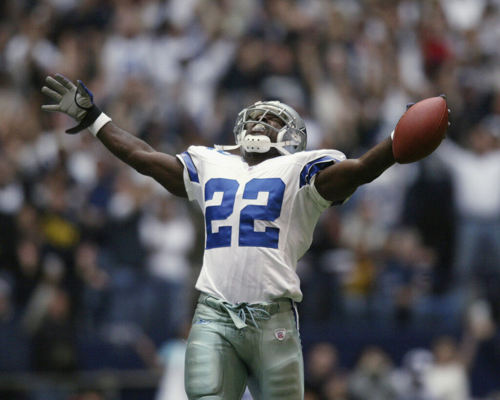 IRVING, TX - OCTOBER 27: Running Back Emmitt Smith #22 of the Dallas Cowboys celebrates beating the NFL rushing record during the NFL game against the Seattle Seahawks at Texas Stadium on October 27, 2002 in Irving, Texas. The Seahawks defeated the Cowboys 17-14. (Photo by Ronald Martinez/Getty Images)